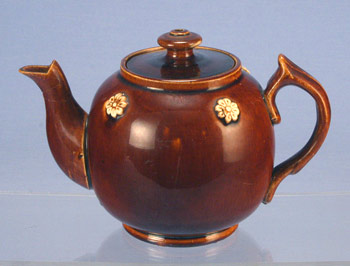 AP/652 - Treacleware brown glazed earthenware teapot with white sprigs (cf. Bargeware or Measham ware). treacleware.co.uk (Rockingham ware)
