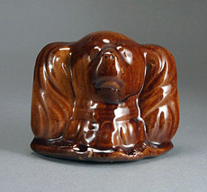AP/381 Treacleware brown glazed earthenware spaniel dog head moneybox. treacleware.co.uk (Rockingham ware)